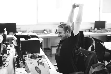 Excited man in call center