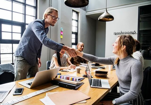 Office Employees Shaking Hands